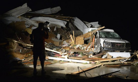 First In Video news video photographer Brad Mack covers the damage seen after a tornado hit the town of Mayflower, Arkansas