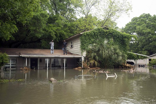 Residents wait for help after flooding in the Kelly Ave. Basin area of Pensacola