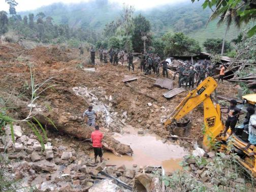 Rescue teams from the Sri Lankan military engage in rescue operation work at the site of a landslide at the Koslanda tea plantation in Badulla