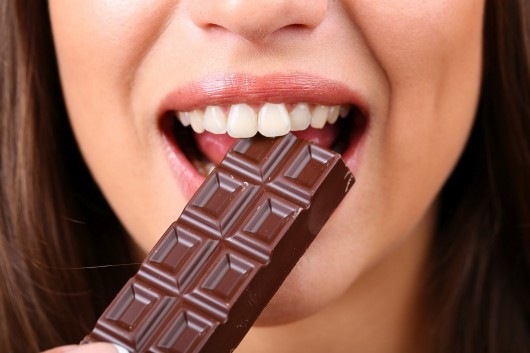 Closeup of woman eating chocolate