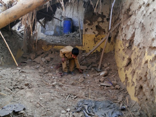 A Pakistani child sifts through rubble at a destroyed religious seminary belonging to the Haqqani network after a US drone strike in the Hangu district of Khyber Pakhtunkhwa province on November 21, 2013. A US drone strike targeting a base of the Haqqani militant network in northwest Pakistan killed six people in only the second such strike outside the country's lawless tribal districts. AFP PHOTO/SB SHAH        (Photo credit should read SB SHAH/AFP/Getty Images)