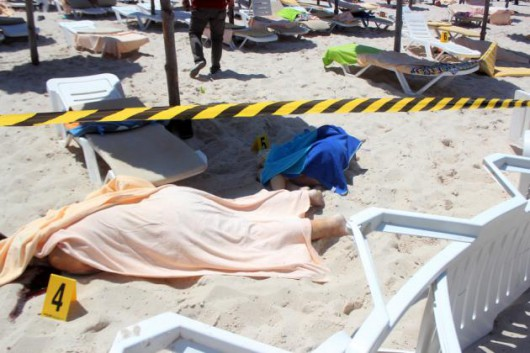 Bodies lie on a beach in al-Sousse, 150 kilometers fromTunisia, 26 June 2015. According to local reports unknown assailants detonated at least one bomb then opened fire on tourists at two hotels, killing at least 27, mostly foreigners, and wounding several others, some while they were sunbathing, at least one of the attackers was killed by Tunisian security services, while a second has been arrested. (EPA/STR)