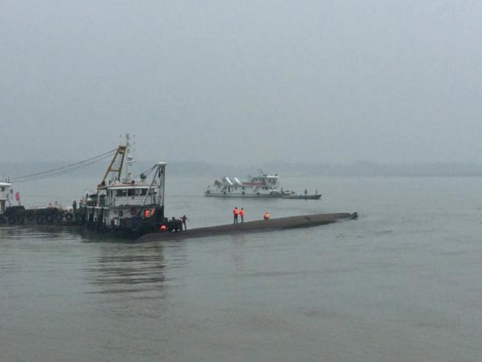 Rescue workers search on a sunken ship in the Jianli section of Yangtze River