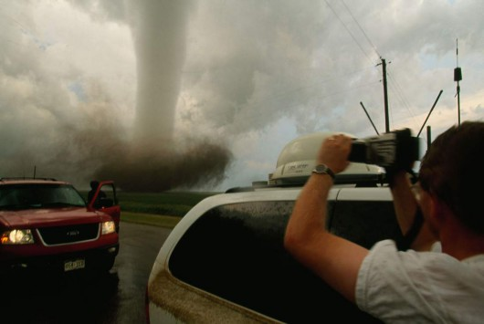 UNITED STATES - MARCH 25:  A storm chaser video taping a very close tornado. South Dakota.  (Photo by Carsten Peter/National Geographic/Getty Images)