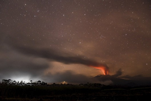 Volcanic ash and clouds are illuminated by lava from the crater of Mount Raung as seen from  Songgon, Banyuwangi East Java, Indonesia on July 11, 2015 in this photo taken by Antara Foto.   Indonesian authorities reopened the main airport on the popular resort island of Bali on Saturday after its closure on Friday due to a volcanic eruption on nearby Java island, an airport official said. Mount Raung in East Java has been erupting for nearly a week, forcing several airports in the region to close and causing widespread flight disruption on Friday. All of the airports, including Lombok international airport, have reopened. Picture taken July 11, 2015 REUTERS/Zabur Karuru/Antara Foto  ATTENTION EDITORS - THIS IMAGE HAS BEEN SUPPLIED BY A THIRD PARTY. IT IS DISTRIBUTED, EXACTLY AS RECEIVED BY REUTERS, AS A SERVICE TO CLIENTS. FOR EDITORIAL USE ONLY. NOT FOR SALE FOR MARKETING OR ADVERTISING CAMPAIGNS MANDATORY CREDIT. INDONESIA OUT. NO COMMERCIAL OR EDITORIAL SALES IN INDONESIA.      TPX IMAGES OF THE DAY