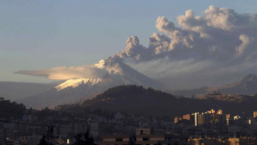 The Cotopaxi volcano, one of the world's most active volcanoes, spews ash and smoke as seen from Quito