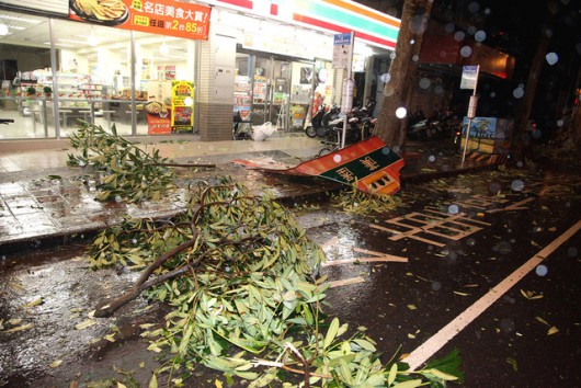 epa04876676 A picture taken in the early hours of 08 August 2015 shows tree branches and a fallen signboard are strewn in front of a 7-11 convenience store in Taipei, Taiwan. Soudelor brought strong winds and heavy rain to Taiwan, leaving two persons dead, five injured and one missing, according to the Central Emergeny Operation Center. The two dead include a 25-year-old Indonesian deckhand working on a Taiwan fishing boat who was killed by a fallen signboard in Ilan County, northern Taiwan. Soudelor landed on Hualien on the east coast at 4:40 AM Saturday (20:40 GMT Friday). Soudelor is expected to leave Tawian around noon Saturday and charge towards Southeast China.  EPA/DAVID CHANG