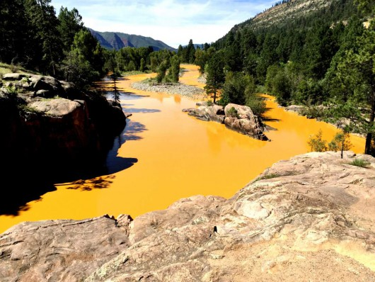 Jerry McBride/Durango Herald 08/06/15-Durango - Mine waste from the Gold King Mine north of Silverton fills the Animas River at Bakers Bridge on Thursday morning.