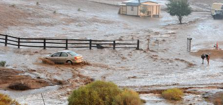 A vehicle crosses a flooded section of Carob Street, Tuesday, Sept. 8, 2015, in Hesperia, Calif. The National Weather Service issued a flash flood warning and severe thunderstorm warning for the area on Tuesday night. (David Pardo/The Victor Valley Daily Press via AP) MANDATORY CREDIT