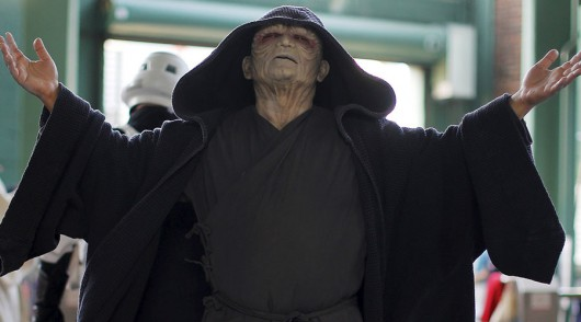 A person dressed as Star Wars character Emperor Palpatine enjoys a cool breeze before the MLB baseball game between the Tampa Bay Rays and the Boston Red Sox at Fenway Park in Boston, Massachusetts, United States May 4, 2015. REUTERS/Brian Snyder TPX IMAGES OF THE DAY - RTX1BK1Y