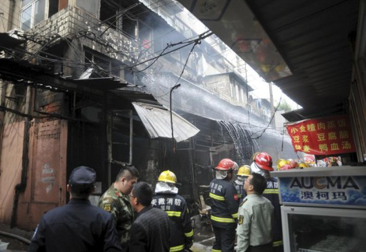 Firefighters try to extinguish a fire after an explosion at a restaurant in Wuhu
