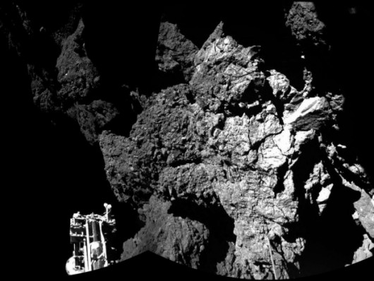 CORRECTS SECOND REFERENCE OF PHILAE - The combination photo of different images taken with the CIVA camera system released by the European Space Agency ESA on Thursday Nov. 13, 2014 shows Rosetta's lander Philae as it is safely on the surface of Comet 67P/Churyumov-Gerasimenko, as these first CIVA images confirm. One of the lander's three feet can be seen in the foreground. Philae became the first spacecraft to land on a comet when it touched down Wednesday on the comet, 67P/Churyumov-Gerasimenko. (AP Photo/Esa/Rosetta/Philae)