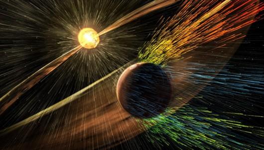 """Wiatr słoneczny """"bombardujący"""" atmosferę Marsa /NASA/GSFC /materiały prasowe"""