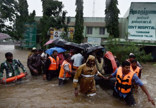 Chennai: Rescuers shifting patients from a flooded hospital after heavy rains in Chennai on Tuesday. PTI Photo  (PTI12_1_2015_000283B)