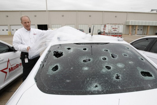 Matt Zavadsky of MedStar, ambulance service, shows hail damage on a response vehicle at their main office on Thursday, March 17, 2016 in Fort Worth, Texas. (Khampha Bouaphanh/Fort Worth Star-Telegram/TNS)