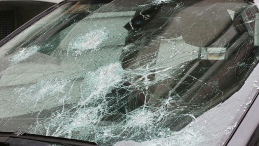 Schwenningen, GERMANY: Picture taken 29 June 2006 shows the font windshield of a car demaged by havy hail in Schwenningen, southern Germany 29 June 2006. Hail and wind storms overnight left one person dead and more than 100 injured in Germany's southwestern state of Baden- Wuerttemberg, the local authorities said. AFP PHOTO DDP/ANDRE GREGG GERMANY OUT (Photo credit should read ANDRE GREGG/AFP/Getty Images)