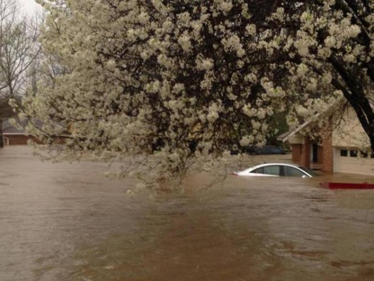 A car lies submerged in the Tall Timbers subdivision after flooding near Shreveport