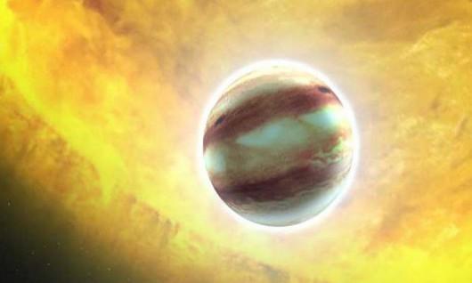 Artystyczna koncepcja egzoplanety tzw. ciepłego Jowisza NASA/ESA