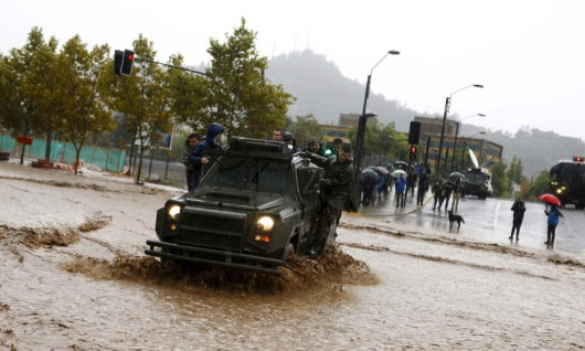 A riot police vehicle crosses a flooded street in Santiago, April 17, 2016. REUTERS/Ivan Alvarado
