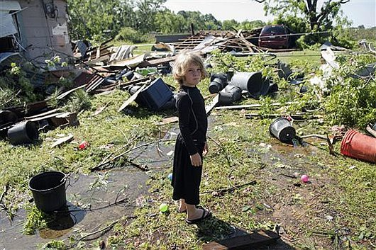 Memphis Melton, 7, looks at the destruction in his aunt's backyard in Lindale, Texas Saturday, April 30, 2016. A suspected tornado came through the area Friday night.  /Tyler Morning Telegraph via AP) MANDATORY CREDIT