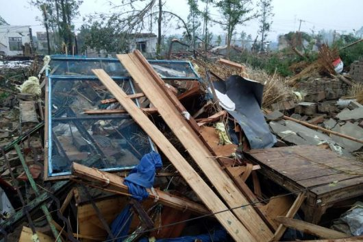 Damaged houses are seen after a tornado hit Funing county, Yancheng