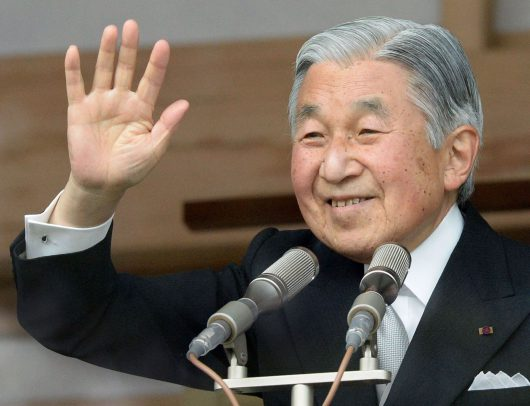 Japanese Emperor Akihito waves to well-wishers celebrating his birthday at the Imperial Palace in Tokyo on December 23, 2013. The emperor turned 80 years old on December 23.    AFP PHOTO/Toru YAMANAKA