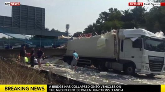 Pedestrian bridge collapses onto vehicles on the M20 motorway in Kent