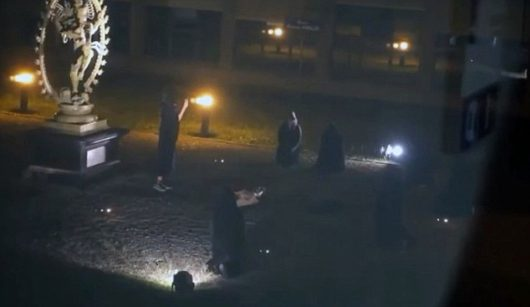 "Pic shows: A woman being sacrificed The European Organisation for Nuclear Research (CERN) has started an investigation into an online video which appears to show a woman being sacrificed in a gruesome ritual on their grounds. The bizarre amateur video - which some media outlets suspect to be fake - shows people dressed in black on facility grounds in Geneva, Switzerland. All are gathered in front of a statue of Shiva, one of the three main deities in Hinduism, as they form a circle around a woman who is lying down on the ground. A person is apparently recording the entire scene from a hiding place as one of the people takes out a knife and appears to stab the woman. The author of the video then gasps and swears before the video abruptly cuts. The footage has been making the rounds online and has been discussed on numerous conspiracy websites with lively debates over what the exact purpose of the 'human offering' is. In a short statement, CERN confirmed they know about the existence of the video but said that no-one was ever sacrificed at their facility. However, even though assured there was no proof of a murder, CERN have nonetheless started an investigation. They noted that the sacrifice might be a practical joke by students who frequent the facility during summer. CERN, an international scientific nuclear research institute in Geneva, is world famous for its Large Hadron Collider (LHC). It is the world's largest and most powerful particle collider and the largest and most complex experimental facility ever built. The institute is perhaps most famous for proving the existence of the Higgs boson, an elementary particle in the Standard Model of particle physics. Despite the many conspiracy theorists, CERN is a recurring focus for bizarre reports in the media. In January, local outlets produced reports of a UFO apparently flying over CERN into what looked like an ""interdimensional portal into the galaxy"". (ends)"