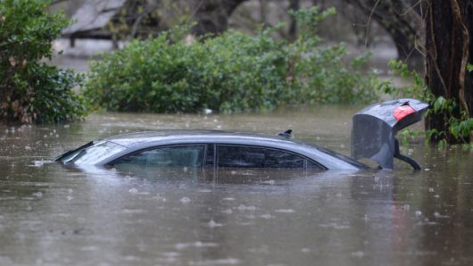 A vehicle is submerged by high water in the Tall Timebers subdivision in Shreveport, La., Wednesday, March 9, 2016. Several parishes in northwest Louisiana have declared a state of emergency over widespread flooding, and the National Guard is being sent in to help. (Douglas Collier/The Times Shreveport via AP)