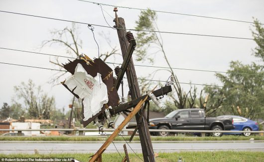 Broken power lines are the remnants of an apparent tornado that touched down in Kokomo, Ind., Wednesday, Aug. 24, 2016. (Robert Scheer/The Indianapolis Star via AP)