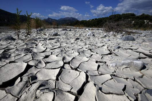 epa05528812 Soil of the Var riverbed is broken due to low water level and recent hot temperatures in Carros, France, 07 September 2016. Southern France is experiencing dry weather and drought, reportedly the worst one of the last decade.  EPA/SEBASTIEN NOGIER
