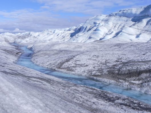 icy river on Greenland ice sheet
